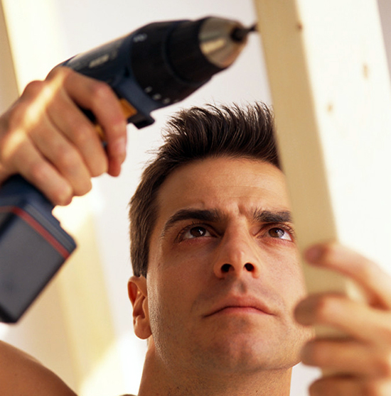 Man Using Electric Drill